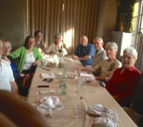 a group of former internees and family members at lunch