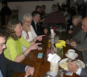 former internees and families at lunch