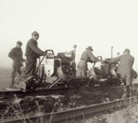 small group of internees work on the railroad