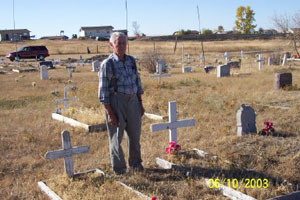 Max at Alma Thunder Hawk's Grave in 2003