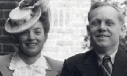 photo of the couple, she wearing hat tipped at rakish angle