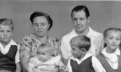 Schmitz family, parents with four children