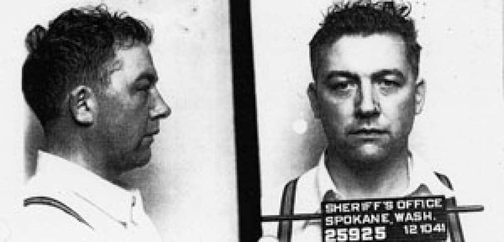 """profile and head-on photos of Karl Vogt, with """"Sheriff's Office, Spokane, Wash."""" and date on sign in front of him-standard """"mug shot"""""""