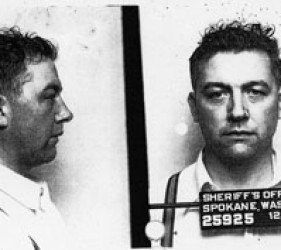 "profile and head-on photos of Karl Vogt, with ""Sheriff's Office, Spokane, Wash."" and date on sign in front of him-standard ""mug shot"""