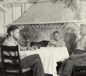 3 men at a table