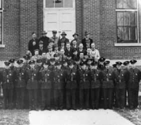 the staff of Ft. Lincoln, lined up in front of brick building