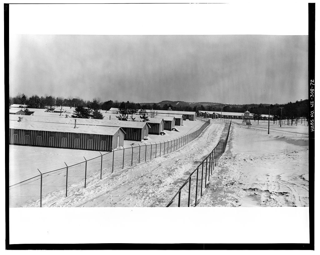double chainlink fences along road and buildings-snow