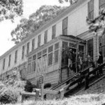 photo of exterior of barracks building, perched on a hill