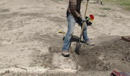 man shoveling dirt