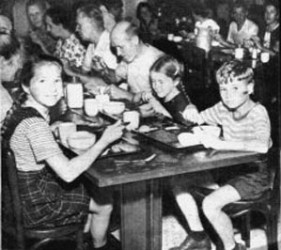 meal time; children and adults at long tables