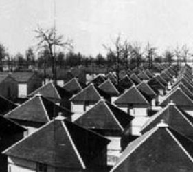 rows of square huts with tent-like roofs