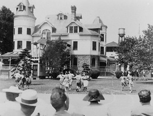 Female internees at Gloucester City dancing for Justice Department audience in 1943, reportedly hoping to win their release. Note fence around facility.National Archives Photo.