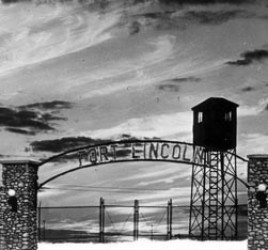 sunset view of Fort Lincoln entry gate arch and guard tower