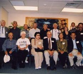 group of former internees, seated and standing