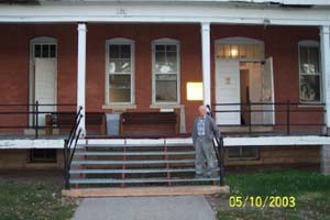 Max Ebel stands in front of Building L-33 where he lived, now a UTTC dormitory. October 2003.
