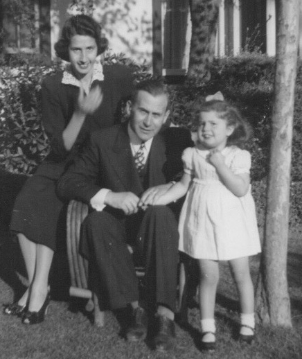 photo of father, mother, daughter
