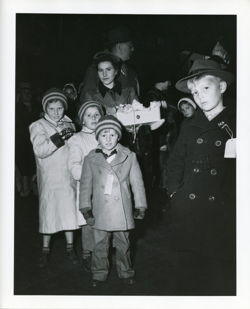 Feb. 1944-woman with a number of children waits in line