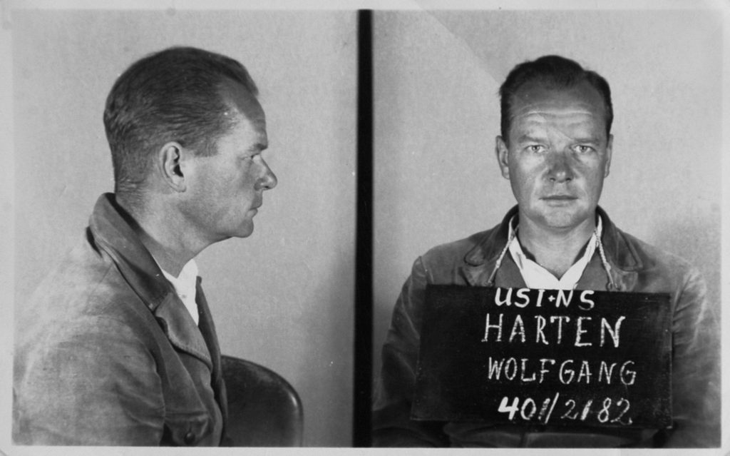 man in mug shots, side/front